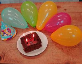 birthday balloons and cake