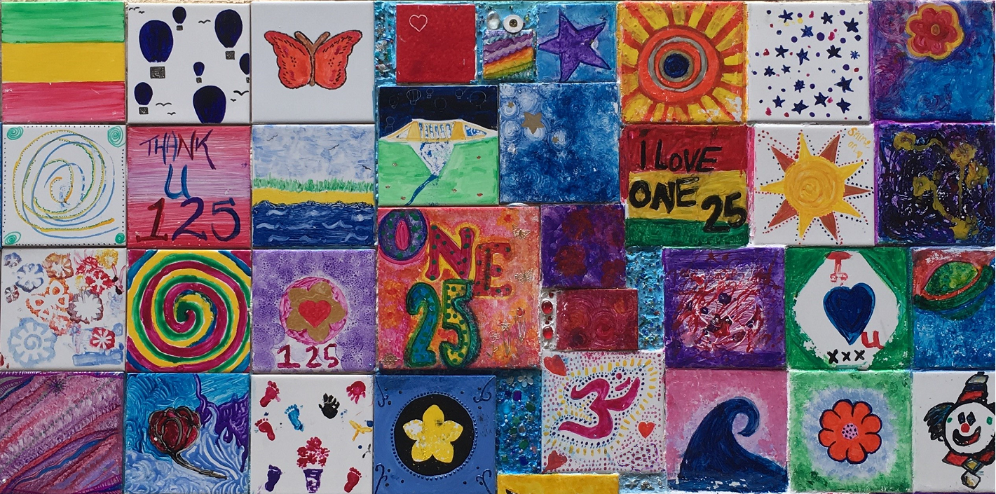 painted tiles with messages like