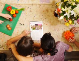 vegetables, flowers and a hug of support round a table
