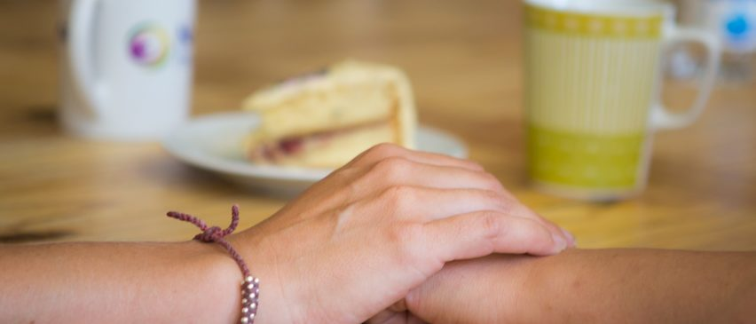 reassuring hand on hand