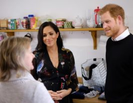 TRH the Duke and Duchess of Sussex speak to a One25 volunteer