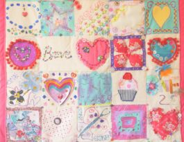 the wall hanging made by women in drop-in and creative volunteer Jemima