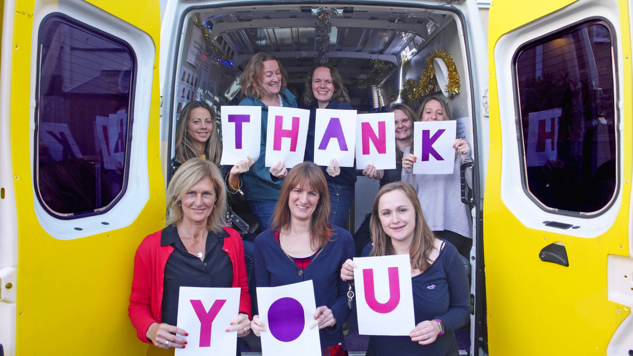One25 staff say thank you on the van