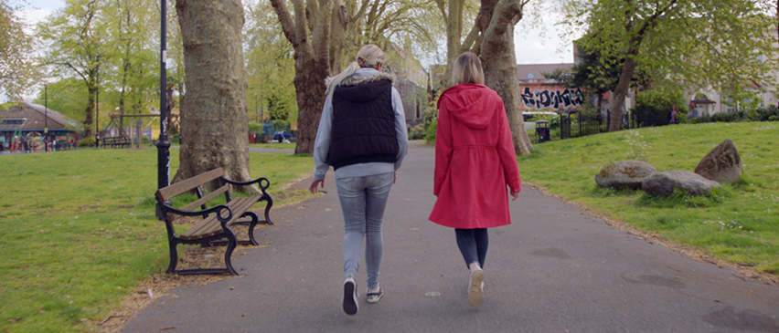 Two women walk the path together